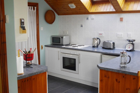 well equipped kitchen in this comfortable                         and quiet holiday apartment